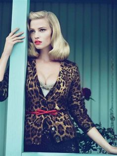 Vogue - 50´s  I have a similar cardigan and belt. Maybe not so plunging