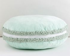 Here's a sweet treat for naptime! Our plush macaron-shaped sherpa pillow brings the charm of a French pastry shop to a little one's nursery and play space.