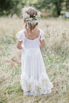 Oh my gosh so precious! This sweet flower girl looks like a mini bohemian bride!