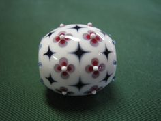such precision transformed simple raised and stacked dots, some raked, into this gorgeous bead!