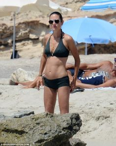 Fun in the sun: On Wednesday Jennifer Connelly soaked up the sun with her husband Paul Bettany
