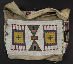 "Lakota Beaded Buffalo Hide Possible Bag, last quarter of 19th c., the front, flap and sides. tin cone danglers with purple feathers, 13"" x 19""."