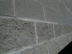 Here are two different styles of concrete block. The first two courses are split-faced block made to resemble stone. The block above it is t...