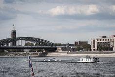 The Rhine (Rhein) river with the Hohenzollern bridge (Hohenzollernbrücke), the RTL Media offices and the Hyatt Regency hotel in Cologne (Köln), Germany