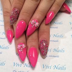 Pink stiletto nails with bows
