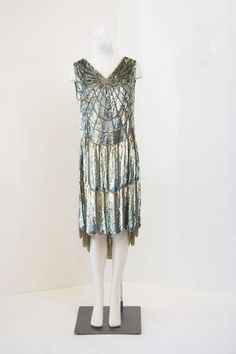 French sequined flapper dress, c. 1920s. Flapper-style cocktail dress with overall hand-beading in shades of turquoise and blue, web-like bodice and two-tier skirt with scalloped hem.