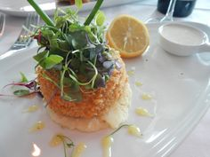 Chops Grille. One of our favorite appetizers is the dungeness crab and shrimp cake, served with a delectable rémoulade sauce.