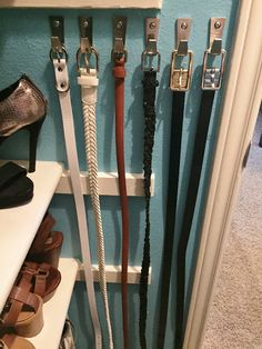 DIY closet makeover and organization project. Click or visit FabEveryday.com to see more photos and details. In this photo, @IKEAUSA Blecka hooks made a great way to organize belts.