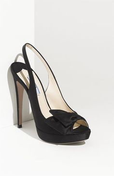 """All I can say is """"Helloooo Lover!"""".... Gaah! not sure if it comes in other colors - but love this Prada Slingback - would look great with your dress!"""