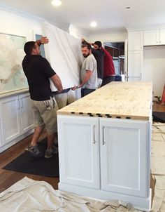 white-kitchen-remodel-carrying-in-double-thick-island. The secret is that it's not actually extra thick. Whenever someone asks how it's done, we liken it to the lid of a shoe box. It just has side pieces around the edges that were mitered and glued to look as if it's truly a super thick solid slab. And since they were able to cut all the sides from the same slab, the only extra cost was for fabrication – not extra material.