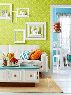 Color love, wall art love - fabulous! What a fun space! You can even DIY that coffee table! More furniture projects visit: http://www.bhg.com/decorating/makeovers/furniture/furniture-projects/