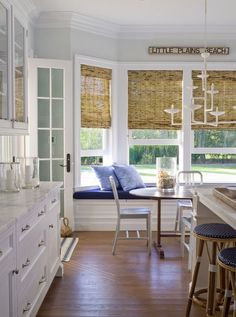 Southampton - Traditional - Kitchen - New York - Orrick & Company - like the woven woods in breakfast room. Shaker Style Kitchen Cabinets, Shaker Style Kitchens, Kitchen Cabinet Styles, Glass Cabinets, Cream Cabinets, Farmhouse Kitchens, White Cabinets, Kitchen Window Decor, Kitchen Windows