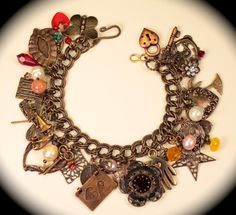Antiqued brass charm bracelet with vintage hearts, beads and charms.