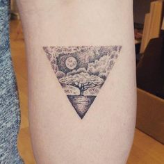 Hand poked tree triangle tattoo on Daniella's calf.