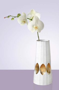 Gilded leaf patterns give this white porcelain vase some extra oomph.