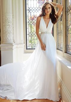 A-line silhouette with v-neck neckline and chapel train length | Sophia Tolli | https://www.theknot.com/fashion/y21435-joanne-sophia-tolli-wedding-dress | https://moncheribridals.com/collections/wedding-dresses/sophia-tolli/?utm_source=theknot.com&utm_medium=referral&utm_campaign=theknot&utm_content=gallery