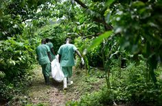 This photo shows doctors burying another victim of the ebola virus.