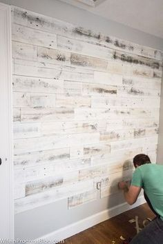 Reclaimed wood wall - a stunning accent wall for any room!