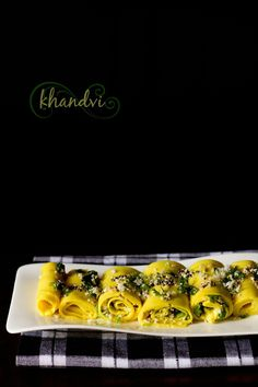khandvi recipe with step by step photos – melt in the mouth, smooth, spiced & seasoned gram flour rolls. khandvi is a delicious healthy snack from the gujarati cuisine. Gujarati Cuisine, Gujarati Recipes, Indian Food Recipes, Vegetarian Recipes, Cooking Recipes, Easy Cooking, Muthia Recipe, Khandvi Recipe, Yummy Healthy Snacks
