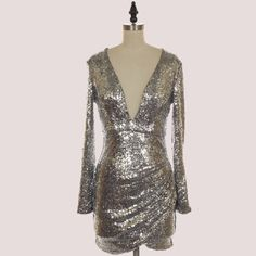 What Happens in Vegas!!! Be the light at any party in this sequin v-neck roughed dress!! This is a season statement and staple !!!  only $79.00 at - www.lookoftheday.com