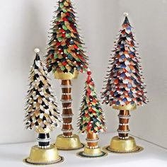 Recycled aluminium cans and Nespresso capsules are used to make miniature Christmas trees