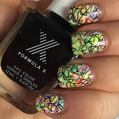 Rainbow neon tie dye watermarble nails with stamping done using Cheeky Plate