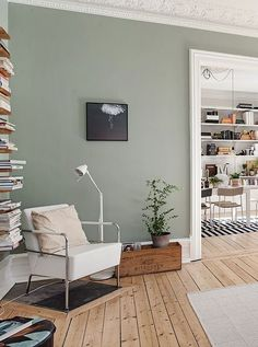 Sage green walls and a rustic, knotty floor. This room echos the sentiment of simplicity in a really fresh & cool way. www.naturalwoodfloor.co.uk