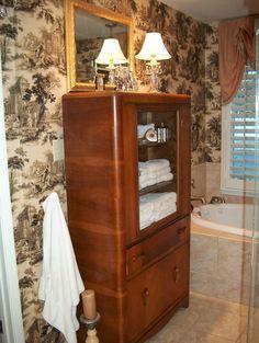 My master bathroom towel & toiletries storage, a vintage china cabinet.