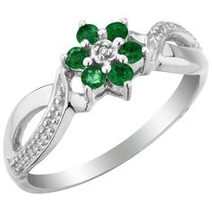 "The central stone was a four-carat diamond and, surrounding it, were a number of emeralds.  It reached to the knuckle of her finger and gave her hand the appearance of being weighted down.  Scarlett had a suspicion that Rhett had gone to great pains to have the ring made up and, for pure meanness, had ordered it made as ostentatious as possible."" --Gone with the Wind"