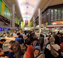 Omi-cho Market photo  The Omi-cho Market was established about the middle of the 18th century. Since then, it has been supporting the gastronomic culture of Kanazawa for more than 280 years. There are as many as 170 stores including a large number of fish stores that sell fresh fish and seafood caught in the Sea of Japan, vegetable stores that sell unique Kaga vegetables, fruit stores, dried food and marine product stores, grocery stores, and clothing stores besides restaurants. Crabs…