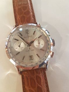 I am selling this Eberhard Extra/Fort chronograph because I don't use it. New and original, never worn. Brown crocodile leather strap which is 11 cm long on the 6 o'clock side and 9 cm long on the 12 o'clock side. Automatic mechanical movement, soleil silver-coloured dial, domed anti-reflective sapphire crystal, screw-down crown, case back fastened with 6 screws, 5 ATM, case diameter: 39 mm, lug width: 20 mm, 19 mm steel buckle. The watch in perfect working order and has neve...
