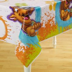 """Scooby Plastic Tablecover by Hallmark Marketing Corporation. $6.99. Kids Birthday Tablecovers. 1 per package.. Scooby Birthday Plastic Tablecover is 54"""" x 102""""."""