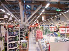 Weber Industrigolv i Dollarstore Östersund. Ett gammalt lokstall gjordes om till butik. För att få ordning på det ojämna golvet användes Weber Industrigolv. Times Square, Travel, Viajes, Trips, Tourism, Traveling