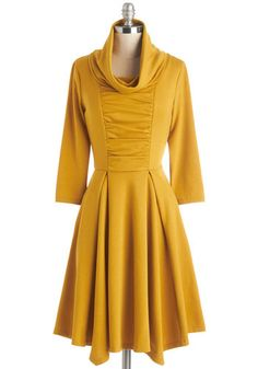 Storytelling Showstopper Dress in Goldenrod - 3/4 Sleeves. Standing center stage, you share an adventurous anecdote while wearing the cute cowl neck and pleated skirt accents of this ModCloth-exclusive dress! #gold #prom #modcloth