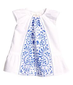 BABY EXCLUSIVE/CONSCIOUS. Dress in woven organic cotton fabric with a printed pattern at front. Elasticized neckline, short ruffled sleeves, and ruffle at hem. Lined.