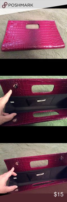 Burgundy Clutch faux leather Pretty burgundy clutch made of faux leather . Great for carrying out to a nice dinner or a party Bags Clutches & Wristlets