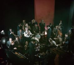 Overhead view of a jam session of jazz musicians, held in the photographer's studio, NY, 1943. Those visible are Duke Ellington, Mezz Mezzrow, Eddie Heywood, Pearl Primus, Teddy Wilson, Lou McGarity, Bobby Hackett, Sidney Catlett, John Simons, Mary Lou Williams, Irving Fazola, Eddie Condon, Wilbur De Paris, Franz Jackson, Billie Holiday, James P. Johnson, Cozy Cole, Al Mott, Josh White, Lester Young, and Count Basie. (Photo by Gjon Mili/Time & Life Pictures/Getty Images)