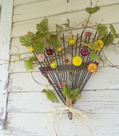 rake wreath > Or stick the handle in the ground & use it as a trellis?