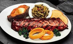 $15 for $30 of food and drinks at Woody's BBQ in Kendall