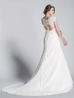 simple front, detailed back. White On White Bridal wedding dress