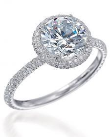 Round diamonds are one of the most popular cuts, so we definitely had a hard time picking just a few of our favorite engagement rings in this category, but we did it. We've pulled together some of the most beautiful (and sparkly) round-cut diamond rings so you can browse through them all in one place.