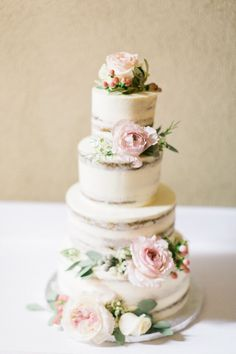 lightly iced wedding cake with flowers - photo by En Route Photography http://ruffledblog.com/spanish-destination-wedding-in-the-woods