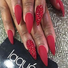 Another way to make red nails even sexier is to opt for a stiletto shape. No matter what nail color you choose, stiletto nails are sexy. But red takes them to the next level. day nails easy nailart Red Matte Stiletto Nails with Red Rhinestones Red Nail Art, Red Acrylic Nails, Red Ombre Nails, Red Art, Holiday Nails, Christmas Nails, Christmas Colors, French Christmas, Christmas Holiday