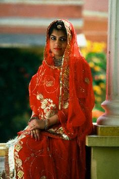 Princess Rupina Kumari Sing, a member of the Jaipur royalty, wears an ornate, red wedding dress, India