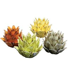 Set of 4 artichoke tea light holders.