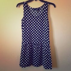 Black and white Polka dot tunic dress Forever 21 Small polka dot top/dress, tunic style with a drop waist. It is very flattering and can be worn numerous ways. I layer it over leggings in the spring, and sometimes wear it as a last minute cover up in the summer. It is cute under a cropped sweater for fall. Forever 21 Dresses