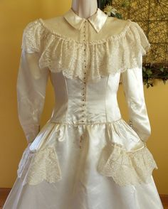 Vintage heavy ivory satin wedding dress with lace edged panniers long attached train S/M. $99.00, via Etsy.