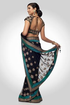 Enhanced with ornate motif this drape is distinctive for a magnificent occasion. An intimidating drape in unique colors is enhanced with decorous border. The ornate motifs highlight this exclusive ensemble with a resplendent blouse.