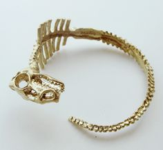 Dinosaur Skeleton Cuff Bracelet in Gold Jewelry Box, Jewelry Accessories, Fashion Accessories, Jewelry Design, Fashion Jewelry, Unique Jewelry, Bone Jewelry, Cuff Jewelry, Jewelry Ideas