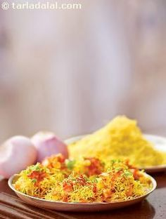 This is another favourite chaat sold on Mumbai streets. Every bhelwala has his own recipe of sevpuri. Sevpuri, as the name indicates is sev topped on puris or papadis, along with potatoes and chutneys. Tangy, crisp and tongue tickling are some words that come to my mind when I think of sevpuri. The very thought makes my mouth water as I reach out to make this delicious chaat!